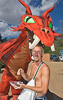 The Renaissance Fair is held each September at the historic museum of El Rancho de Las Golondrinas near Santa Fe and features dancers, kinghts, acrobats and many other performers all celebrating the culture and life style of the Medieval Middle Ages. Visitor Pista Brandauer meets the Red Dragon.