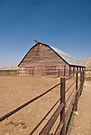 Weathered wooden barn and bare corral, Elko County, Nevada.