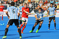 Ian Sloan of England and Gonzalo Peillat try to win the ball during the Hockey World League Semi-Final match between England and Argentina at the Olympic Park, London, England on 18 June 2017. Photo by Steve McCarthy.