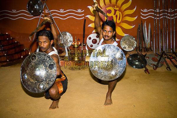 Kalarippayattu martial arts performers posing, Kerala Kalari Centre, Kumily, Kerala, India