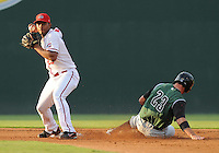 Shortstop Xander Bogaerts (23) of the Greenville Drive makes the putout at second on Devin Harris (23) of the Augusta GreenJackets, but misses a chance at a double play, in a game against the Greenville Drive on August 27, 2011, at Fluor Field at the West End in Greenville, South Carolina. (Tom Priddy/Four Seam Images)