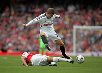 Pictured: Mark Gower of Swansea (TOP) is tackled by Francis Coquelin of Arsenal. Saturday 10 September 2011<br />