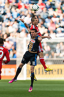 Sebastien Le Toux (11) of the Philadelphia Union goes up for a header with Ryan Richter (33) of Toronto FC. Toronto FC and the Philadelphia Union played to a 1-1 tie during a Major League Soccer (MLS) match at PPL Park in Chester, PA, on April13, 2013.