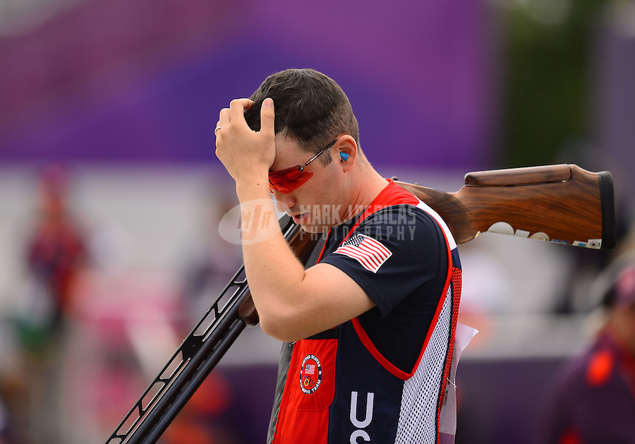 Aug 2, 2012; Greenwich, United Kingdom; Joshua Richmond (USA) reacts during the men's double trap competition at the London 2012 Olympic Games at Royal Artillery Barracks. Mandatory Credit: Mark J. Rebilas-USA TODAY Sports