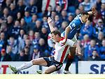 Lee Wallace makes his way past Falkirk's Aaron Muirhead
