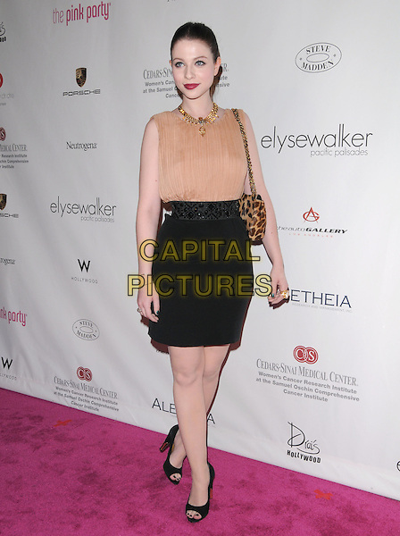MICHELLE TRACHTENBERG.at 6th Annual Pink Party held at Drai's at The W Hotel in Hollywood, California, USA, September 25th 2010..full length gold necklace sleeveless beige peach top beaded waistband dress skirt black open toe shoes leopard print bag                                                                             .CAP/RKE/DVS.©DVS/RockinExposures/Capital Pictures.