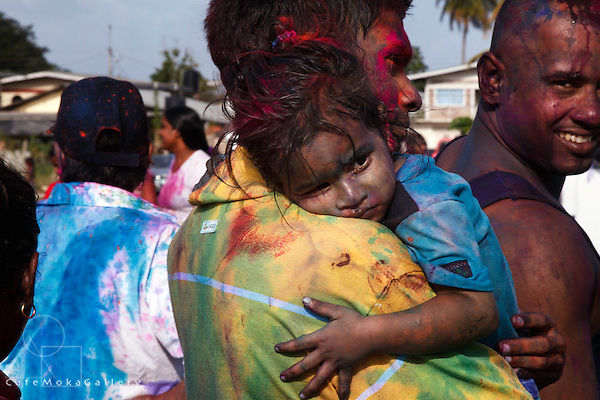 Phagwa or Holi - father holding sleepy daughter covered in dye - Felicity