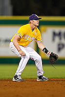 Shortstop Mike Lowery #14 of the LSU Tigers on defense against the Wake Forest Demon Deacons at Alex Box Stadium on February 18, 2011 in Baton Rouge, Louisiana.  The Tigers defeated the Demon Deacons 15-4.  Photo by Brian Westerholt / Four Seam Images