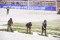 Workers clear snow off the field prior to the second leg of the MLS Eastern Conference Semifinals between the New York Red Bulls and D. C. United at Red Bull Arena in Harrison, NJ, on November 7, 2012.