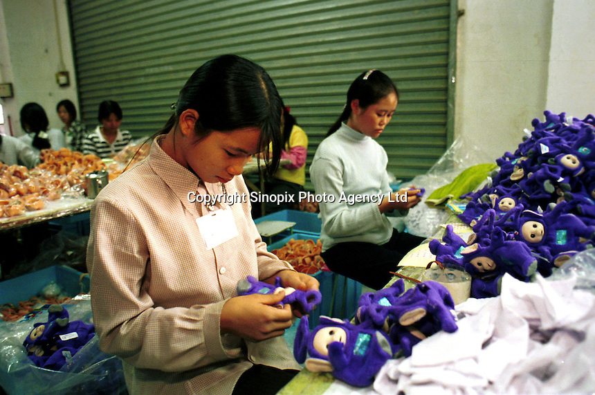 Female workers complete Christmas orders at a factory making the Telly Tubby, a popular toy in the UK. Workers at this and other toy factories work and live in cramped conditions, earning less than one pound sterling per day.