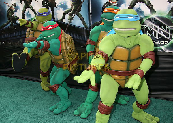 "ATMOSPHERE.""TMNT"" (aka. ""Teenage Mutant Ninja Turtles"") Los Angeles Premiere at Grauman's Chinese Theatre, Hollywood, California, USA, 17 March 2007..full length turtles costumes dressed-up.CAP/ADM/BP.©Byron Purvis/AdMedia/Capital Pictures."