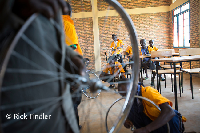 BURUNDI, Ruyigi: 10 June 2015 Ruyigi Re-education Centre Feature.<br /> See accompanying article for general information. <br /> Pictured: Inmates learn how to repair bicycles in a classroom at the centre. <br /> Rick Findler / Story Picture Agency