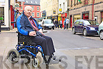 CROSSING: Ardfert native, Denis Stack, who has appealed to motorists not to park on wheelchair ramps on footpaths in Tralee.