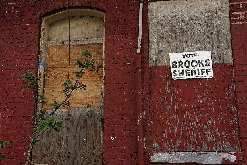 A faded election poster for Sherrif in Baltimore's blighted suburbs. April 30, 2015. to go with Nick O'Malley story.  photo by Trevor Collens