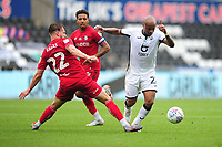 Tomáš Kalas of Bristol City vies for possession with Andre Ayew of Swansea City during the Sky Bet Championship match between Swansea City and Bristol City at the Liberty Stadium in Swansea, Wales, UK. Saturday 18 July 2020