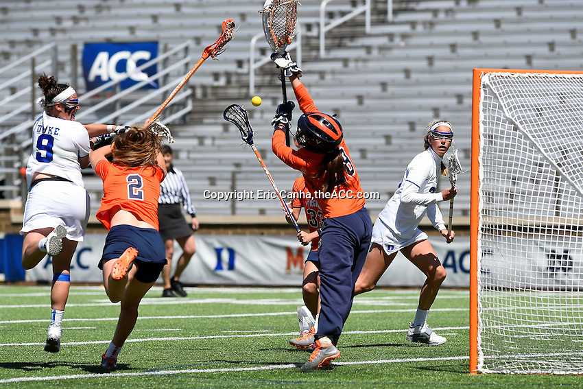 Duke's Kerrin Maurer (09) shoots on Virginia's Liz Colgan (28) during the 2014 ACC Women's Lacrosse Quarterfinals in Boston, MA, Thursday, April 24, 2014. (Photo by Eric Canha,<br /> theACC.com)