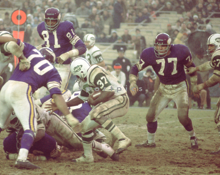 Minnesota Vikings Gary Larsen (77) during a game against the New York Jets on November 29, 1970 at Shea Stadium in Flushing, New York. The New York Jets  beat the Minnesota Vikings 20-10.  Gary Larsen played for 11 years with 2 different teams was a 2-time Pro Bowler.(SportPics)