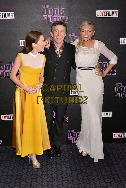 Anna Friel, Steve Coogan, Tamsin Egerton.'The Look of Love' UK film premiere, Curzon cinema, Soho, London, England 15th April 2013.full length hand on hip white dress sheer black belt yellow silk satin black suit arm over shoulder arm smiling mouth open profile sleeveless .CAP/PL.©Phil Loftus/Capital Pictures