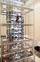 """One of Aurole´s """"angels"""" retrieves a bottle of wine from the restaurtant´s vertical wine cellar at Mandalay Bay, Las Vegas, Nevada, USA"""