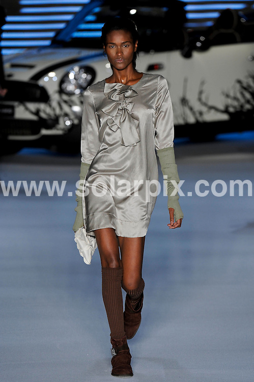 **ALL ROUND PICTURES FROM SOLARPIX.COM**.**SYNDICATION RIGHTS FOR UK AND SPAIN ONLY**.Colcci catwalk show at the Sao Paulo Fashion Week winter collection (SPFW), Sao Paulo, Brazil...This pic: Model displays a creation by Andre Lima.JOB REF:  10541        PRT      DATE:23.01.10.**MUST CREDIT SOLARPIX.COM OR DOUBLE FEE WILL BE CHARGED**.**MUST NOTIFY SOLARPIX OF ONLINE USAGE**.**CALL US ON: +34 952 811 768 or LOW RATE FROM UK 0844 617 7637**