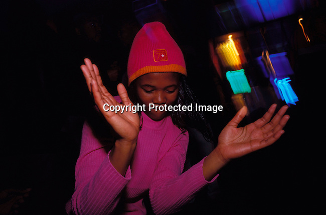 dippnig00103 Nightlife JOHANNESBURG, SOUTH AFRICA - : An Unidentified girl  dancing and partying at a club in Johannesburg, South Africa. Teenagers. .©Per-Anders Pettersson/iAfrika Photos