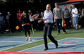 United Statrs President Barack Obama plays tennis during the White House Easter Egg Roll on the South Lawn of the White House March 28, 2016 in Washington, DC.<br /> Credit: Olivier Douliery / Pool via CNP