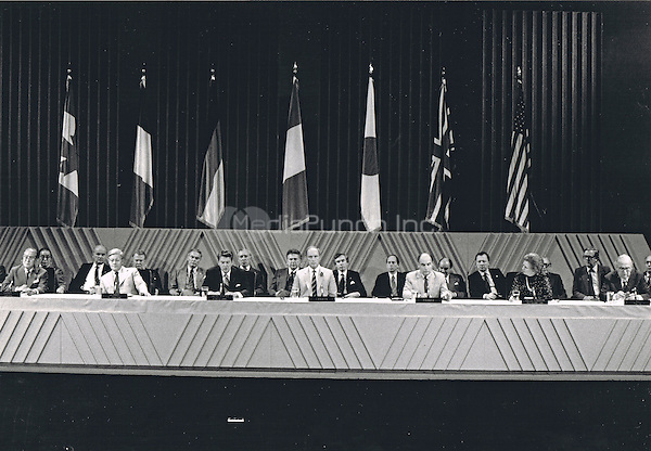 G-7 leaders deliver a joint communique after their meetings in Montebello, Quebec, Canada on July 20, 1981. From left to right at the table: Prime Minister Zenko Suzuki of Japan,  Chancellor Helmut Schmidt of West Germany, United States President Ronald Reagan, Prime Minister Pierre Elliott Trudeau of Canada, President Fran&ccedil;ois Mitterrand of France, Prime Minister Margaret Thatcher of the United Kingdom, and Prime Minister Giovanni Spadolini of Italy. <br /> Credit: Arnie Sachs / CNP /MediaPunch