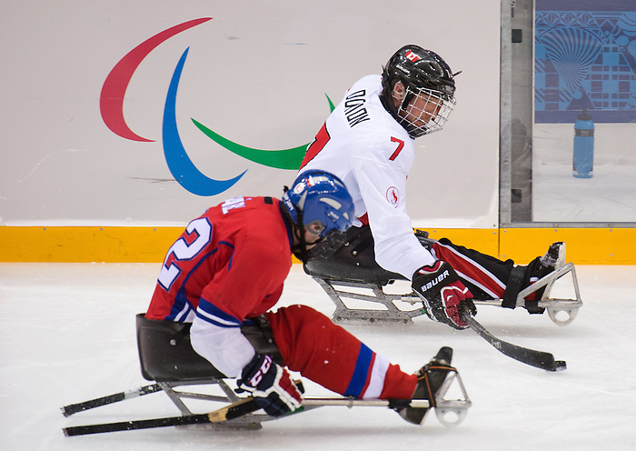 Sochi, RUSSIA - Mar 11 2014 -  Marc Dorion controls the puck as Canada takes on Czech Republic in Sledge Hockey at the 2014 Paralympic Winter Games in Sochi, Russia.  (Photo: Matthew Murnaghan/Canadian Paralympic Committee)