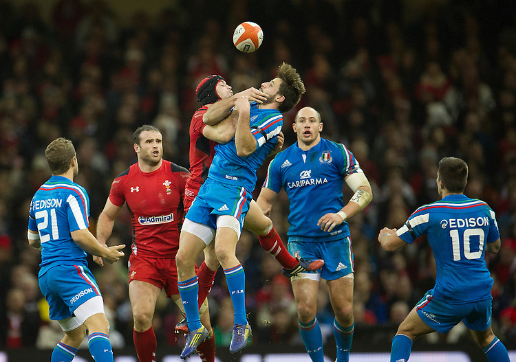 Italy's Tommaso Allan battles for a high ball with Wales' Leigh Halfpenny <br /> <br /> Photo by Stephen White/CameraSport<br /> <br /> International Rugby Union - 2014 RBS Six Nations Championship - Wales v Italy - Saturday 1st February 2014 - Millennium Stadium - Cardiff<br /> <br /> &copy; CameraSport - 43 Linden Ave. Countesthorpe. Leicester. England. LE8 5PG - Tel: +44 (0) 116 277 4147 - admin@camerasport.com - www.camerasport.com