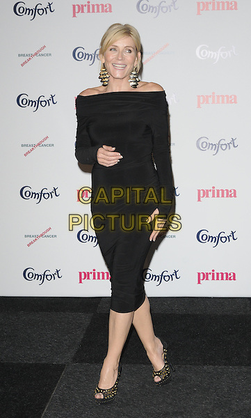 MICHELLE COLLINS.Prima High Street Fashion Awards, Battersea Evolutions, Battersea Park, London, England..September 8th, 2011.full length black dress off the shoulder long sleeves gold studs shoes peep toe smiling gloves fingerless thumbs.CAP/CAN.©Can Nguyen/Capital Pictures.