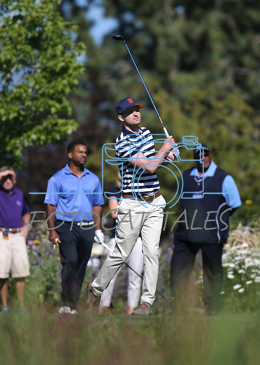 Justin Timberlake tees off during an American Century Championship practice round at Edgewood Tahoe Golf Course in Stateline, Nev., on Wednesday, July 15, 2015. Actor Alfonso Ribeiro is at left. <br /> Photo by Cathleen Allison