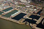 Aerial views of site of Liverpool Waters, part of Mersey Waters Enterprise Zone, to be developed by Peel Group under brand name Peel Waters in derelict docks north of Princes Dock. In the entrance to Salisbury Dock stands the hexagonal Victoria Tower, known as the Dockers' Clock, designed by Jesse Hartley, and built 1847-48