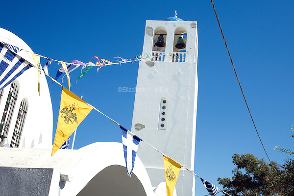 A Greek church with flags in Santorini, Greece on July 4, 2013.