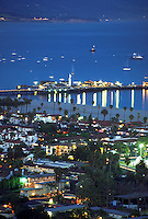 overview of the city of Santa Barbara at dusk with lights from the pier reflecting onto the Pacific Ocean. California.