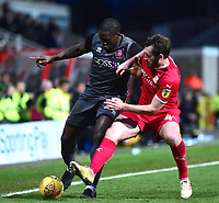 Lincoln City's John Akinde battles with  Swindon Town's Jak McCourt<br /> <br /> Photographer Andrew Vaughan/CameraSport<br /> <br /> The EFL Sky Bet League Two - Swindon Town v Lincoln City - Saturday 12th January 2019 - County Ground - Swindon<br /> <br /> World Copyright &copy; 2019 CameraSport. All rights reserved. 43 Linden Ave. Countesthorpe. Leicester. England. LE8 5PG - Tel: +44 (0) 116 277 4147 - admin@camerasport.com - www.camerasport.com