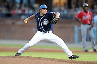Asheville Tourists pitcher Patrick Johnson #14 delivers a pitch during a game against the Rome Braves at McCormick Field on July 25, 2013 in Asheville, North Carolina. The Tourists won the game 9-6. (Tony Farlow/Four Seam Images)