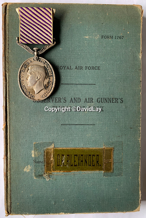 BNPS.co.uk (01202 558833)<br /> Pic:  DavidLay/BNPS<br /> <br /> Flight Sergeant Douglas Alexander logbook and DFM.<br /> <br /> Bomber command heroes WW2 exploits discovered in a shoebox.<br /> <br /> The personal effects of a fearless 'Tail-end Charlie' have been discovered in a shoebox - and they include a charming set of photos of his wartime service.<br /> <br /> Flight Sergeant Douglas Alexander, of 460 Squadron, took part in nearly 40 bombing raids over Germany, including the famous assault on Hitler's mountain retreat, Berchtesgaden.<br /> <br /> As a tail gunner, he sat in a tiny glass turret at the rear of Lancaster and Halifax bombers - a terribly exposed position.<br /> <br /> The shoebox, containing his bravery medals, logbooks and photos, was bought into auctioneer David Lay Frics, of Penzance, Cornwall, by his daughter.<br /> <br /> Flt Sgt Alexander's medal group includes the prestigious Distinguished Flying Medal, awarded for 'exceptional valour, courage and devotion to duty', with his photos capturing the camarederie which existed in the RAF as the airmen risked their lives on every mission to defeat Adolf Hitler.