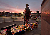 27/01/2018 Jimmy Armfield CBE Statue adorned with flowers and scarves watches over the Blackpool sunset