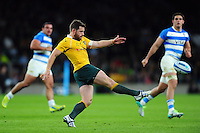 Bernard Foley of Australia puts boot to ball. The Rugby Championship match between Argentina and Australia on October 8, 2016 at Twickenham Stadium in London, England. Photo by: Patrick Khachfe / Onside Images