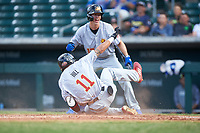 Mesa Solar Sox Derek Hill (11), of the Detroit Tigers organization, slides across home plate for an inside-the-park home run as Jared Young (17) begins to celebrate during an Arizona Fall League game against the Yaquis de Obregon as part of the Mexican Baseball Fiesta on September 29, 2019 at Sloan Park in Mesa, Arizona. Mesa defeated Obregon 7-0. (Zachary Lucy/Four Seam Images)