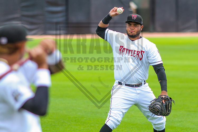 Wisconsin Timber Rattlers catcher Yoel Vasquez (23) warms up prior to a Midwest League game against the Burlington Bees on July 10, 2017 at Fox Cities Stadium in Appleton, Wisconsin.  Burlington defeated Wisconsin 6-3. (Brad Krause/Krause Sports Photography)