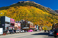 Silverton Colorado crowned with golden aspen topped off with a cobalt blue sky. This old mining town in in the San Juan Mountains of Southeast Colorado.