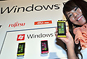 July 27th, 2011, Tokyo, Japan - Models show Toshiba-Fujitsu IS12T handsets, the worlds first Windows Phone 7.5, launched jointly by KDDI, Fujitsu and Japan Microsoft in Tokyo on Wednesday, July 27, 2011. Manufactured by Fujitsu Toshiba Mobile Communications Ltd, the IS12T is Japan's first water and dust-proof smartphone featuring Windows Phone 7.5, otherwise known as Mango. In addition to much smoother operability compared to conventional smartphones, the device offers the highest quality camera for a smartphone with 13.2 - megapixels, and 32 GB of internal memory, while realizing a compact size. Users can not only read and edit Microsoft Office documents, but can also store and share data through Windows Live SkyDrive, a free-of-charge cloud service operated by Microsoft. The Windows phone will be available after September 2011.  (Photo by Natsuki Sakai/AFLO) [3615] -mis-