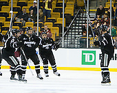 Alex Velischek (PC - 27), Andy Balysky (PC - 33), ?, Barrett Kaib (PC - 8) celebrate Kaib's goal which tied the game early in the first period. - The Boston College Eagles defeated the Providence College Friars 4-2 in their Hockey East semi-final on Friday, March 16, 2012, at TD Garden in Boston, Massachusetts.