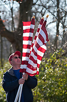 Flags are removed from display at the Westerville Rotary Club's Honor Flight Run in Alum Creek Park. The fund raiser early in the morning helped raise money and awareness for the groups honor Flight program to fly WWII veterans to the world War II Memorial in Washington at no cost.