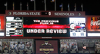 TALLAHASSEE, FL 11/19/11-FSU-UVA111911 CH-The scoreboard tells the story as officials review a play in the final seconds of the Florida State Virginia, Saturday at Doak Campbell Stadium in Tallahassee. The Seminoles lost to the Cavaliers 14-13..COLIN HACKLEY PHOTO