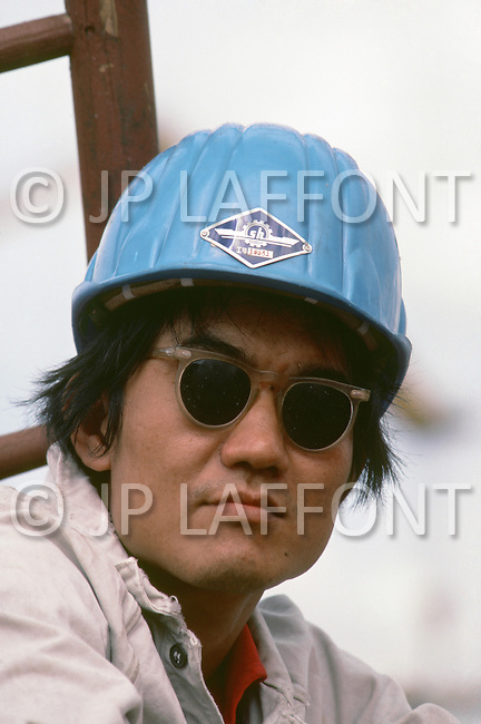 October 1984. Shaghai Shipyard. Workers building ship.