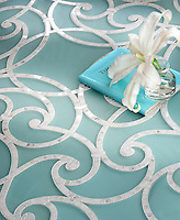 Abigail, a handmade mosaic shown in honed Aquaberyl glass and polished Calacatta. Designed by Sara Baldwin for New Ravenna.<br />