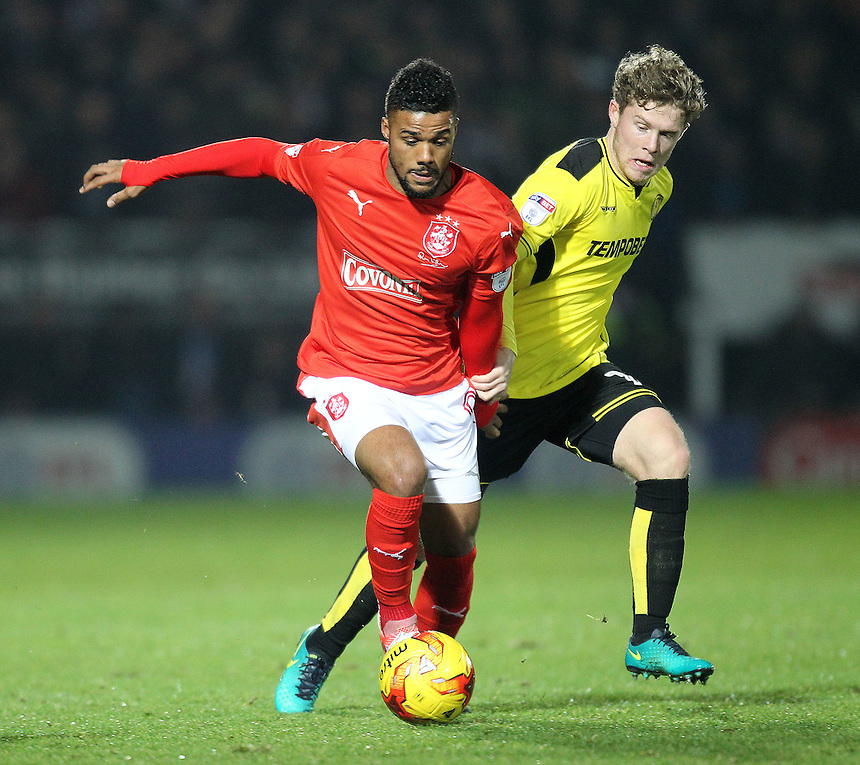 Huddersfield Town's Elias Kachunga battles with  Burton Albion's Matt Palmer<br /> <br /> Photographer Mick Walker/CameraSport<br /> <br /> The EFL Sky Bet Championship - Burton Albion v Huddersfield Town - Tuesday 13th December 2016 - Pirelli Stadium - Burton upon Trent<br /> <br /> World Copyright &copy; 2016 CameraSport. All rights reserved. 43 Linden Ave. Countesthorpe. Leicester. England. LE8 5PG - Tel: +44 (0) 116 277 4147 - admin@camerasport.com - www.camerasport.com