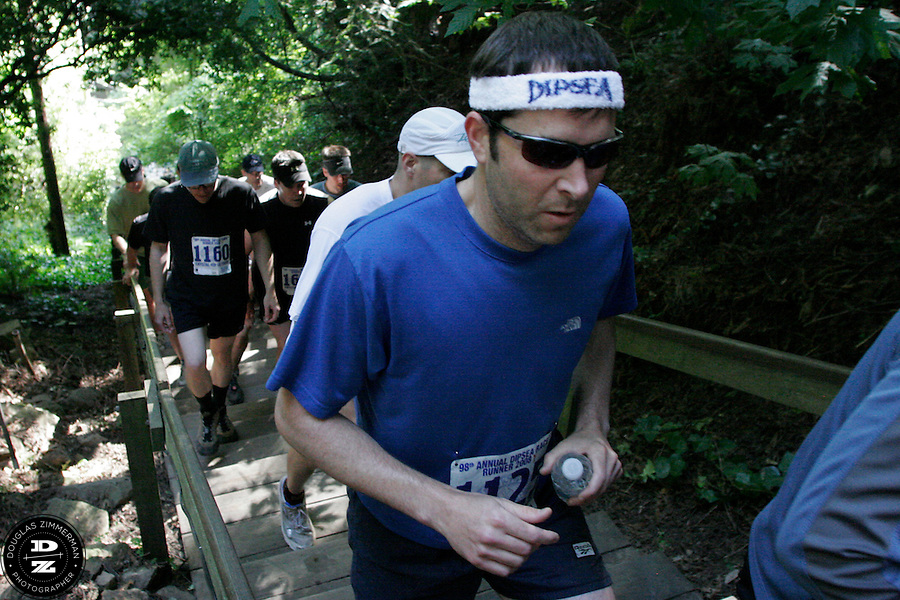 Matthew Sade (1125) of Oakland, Calif. joins other runners making their way up the Dipsea stairs in Mill Valley, Calif on Sunday, June 8, 2008.  The Dipsea starts in Mill Valley, goes over Mt. Tamalapais, and ends in Stinson Beach.